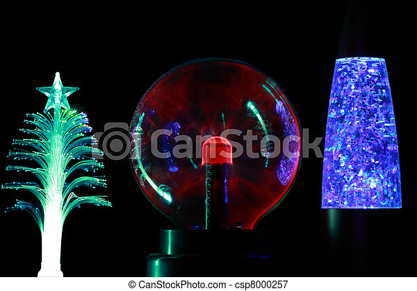 Three souvenir lamps of different form: conifer, round  red and cylindrical blue  on black background. - csp8000257