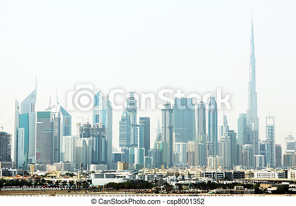 Dubai cityscape with skyscrapers and other buildings at sunny day - csp8001352