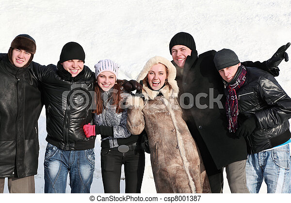 Students stand together hugging hands and laugh - csp8001387