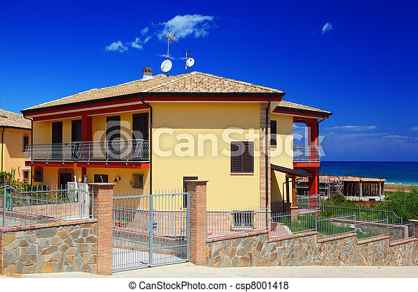 Fenced yellow two-story cottage with garden snd balcony on coast - csp8001418
