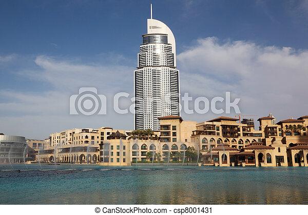 DUBAI - APRIL 17: Burj Dubai Lake Hotel and other buildings near water, sunny day with blue sky, 17 april 2010 in Dubai, UAE - csp8001431
