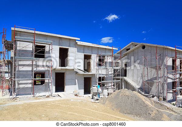 Building of new two-story white concrete house with stairs and balcony - csp8001460
