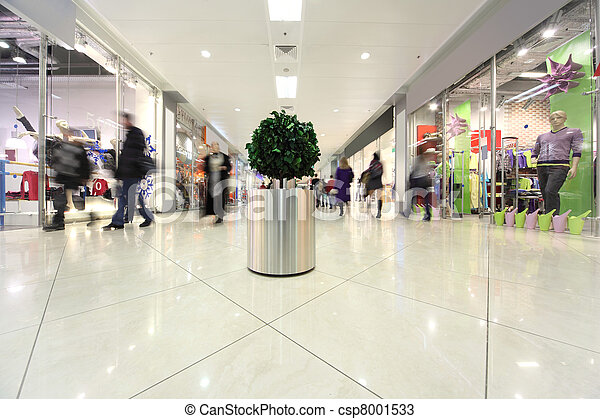 white corridor in shopping mall, potted tree and people in motion - csp8001533