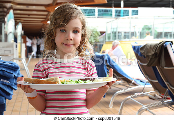 little girl standing and holding tray with food on cruise liner deck, half body - csp8001549