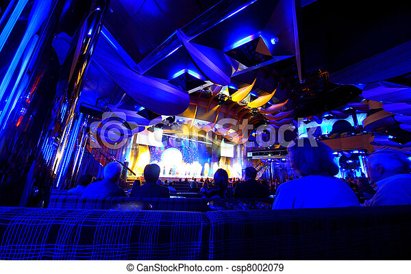 Old people watching concert in the dark room on the cruise ship - csp8002079