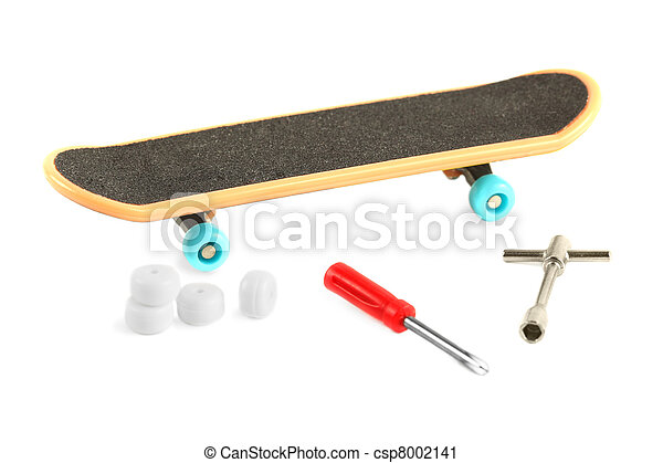 Black skateboard with yellow edge and blue wheel near tools and additional white wheels - csp8002141