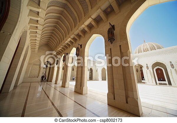 building with arcs inside Grand Mosque in Oman. wide angle. tourists. - csp8002173