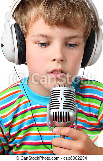 Little cheerful boy in headphone with microphone in hands opened slightly mouth  on a white background  - csp8002234
