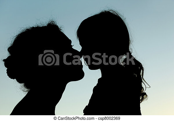 silhouette of mother and daughter touching noses, side view, sky - csp8002369