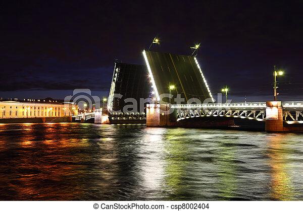 Palace Bridge drawbridge on Neva river at night. Saint-Petersburg, Russia - csp8002404