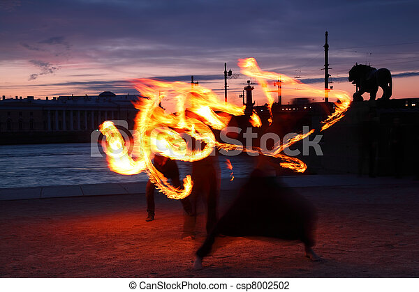 Presentation with fiery light painting streaks at night in Saint-Petersburg, Russia. - csp8002502