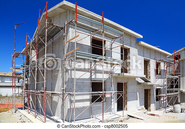 Construction of building of new two-story white concrete house with stairs and balcony - csp8002505