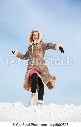 Girl hurries forward on snow in winter and swings arms - csp8002506