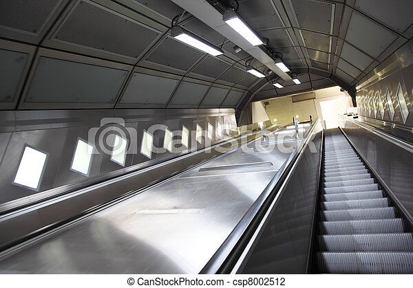 Rise on an escalator in the underground metal corridor - csp8002512
