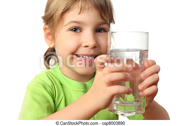 portrait of little girl in green shirt holding glass with water and smiling - csp8003890