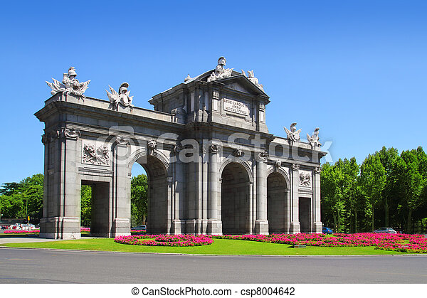 Madrid Puerta de Alcala with flower gardens - csp8004642