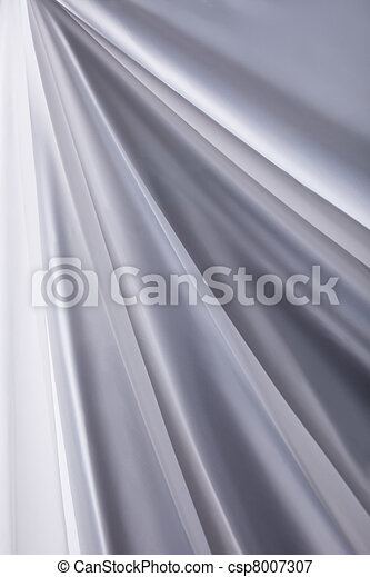 white silk cloth waves background texture close-up - csp8007307