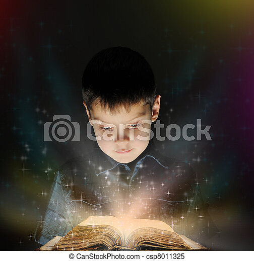 Boy is reading a magic book - csp8011325