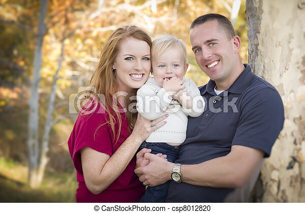 Young Attractive Parents and Child Portrait - csp8012820