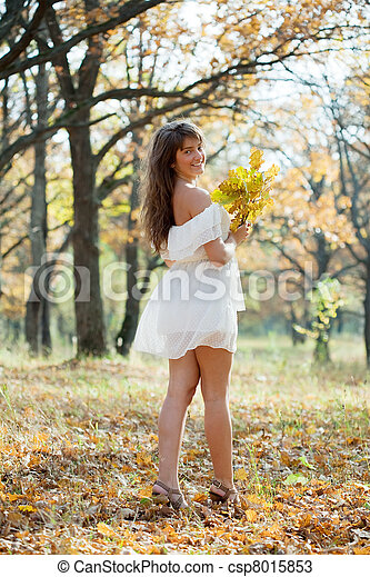 long-haired girl with oak posy in autumn  - csp8015853