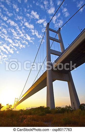 Tsing Ma Bridge in Hong Kong at sunset time - csp8017763