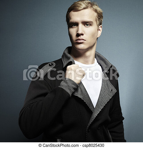 Fashion portrait of the young beautiful man - csp8025430