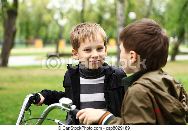 Boy on a bicycle in the green park - csp8029189
