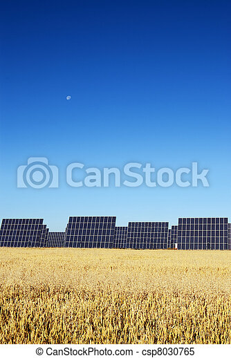 Solar panels, under blue sky - csp8030765
