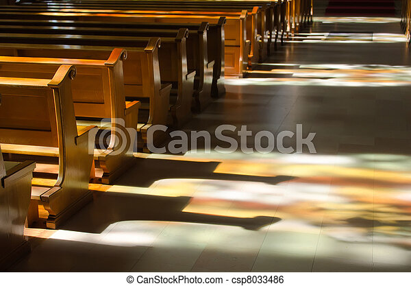 reflection of the stained glass windows inside a church - csp8033486