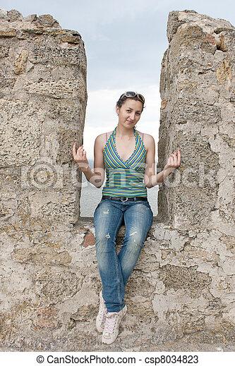 photos de a girl assied dans a niche de a pierre mur photo csp8034823 recherchez. Black Bedroom Furniture Sets. Home Design Ideas