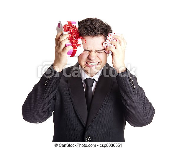 A angry man holding present box in formal black tux - csp8036551