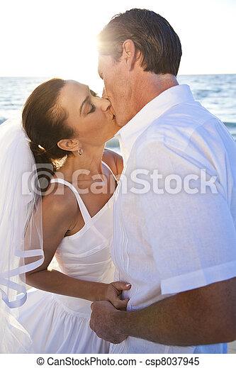 Bride & Groom Married Couple Kissing Sunset Beach Wedding - csp8037945