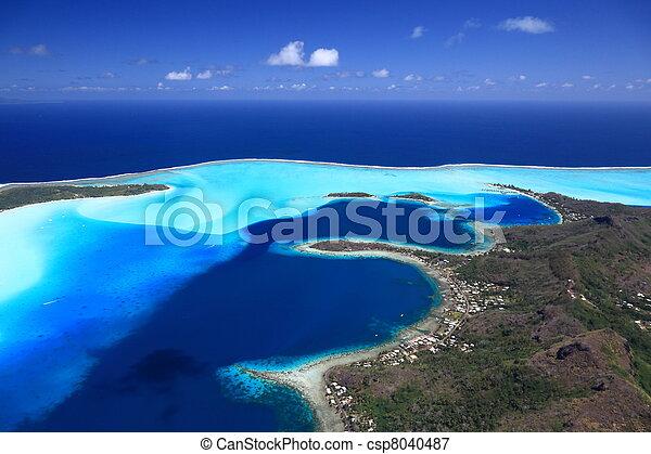 Bora Bora Lagoon, Motus and Main Island in French Polynesia from above. Dreamlike colors. - csp8040487