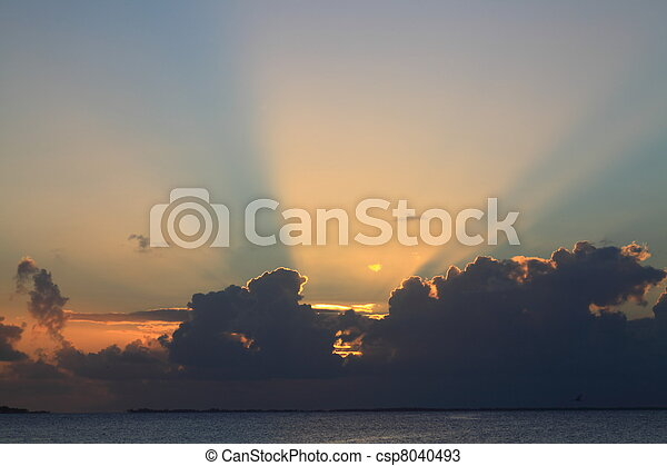 Sunset with Sunbeams at Manihi Atoll in the South Pacific with Coconut Trees - csp8040493