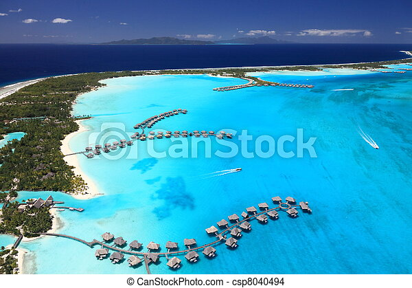 Bora Bora Lagoon, French Polynesia from above. Dreamlike colors. Some Overwater Bungalows are in View  - csp8040494