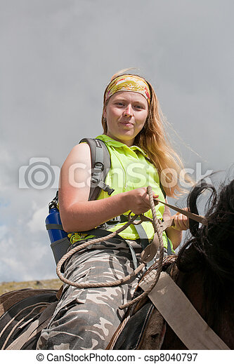 girl is on horseback. Horse tourism. - csp8040797