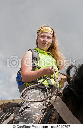 girl is on horseback. Horse tourism. - csp8040797