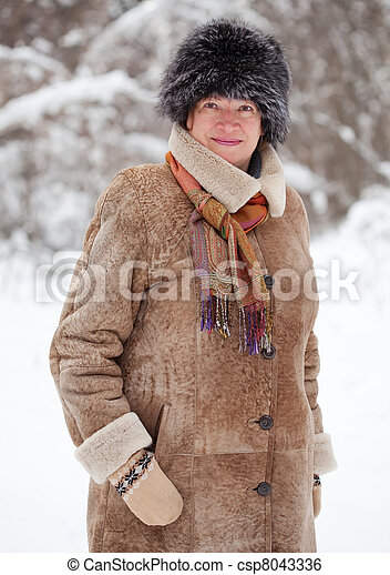 mature woman in wintry forest - csp8043336