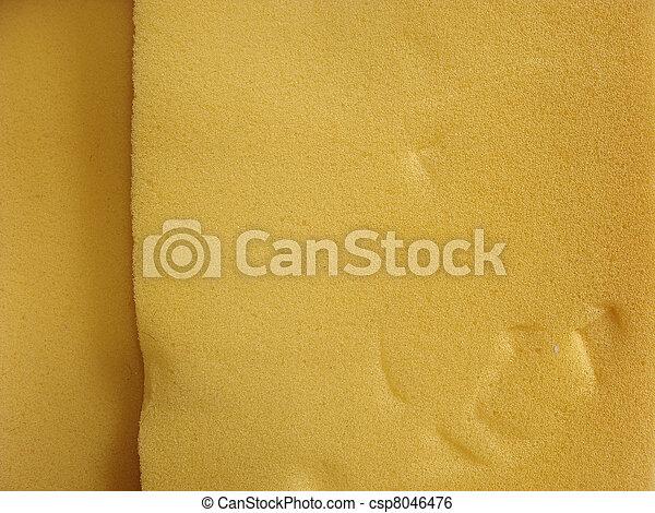 close view of orange industrial foam substance                                                                                              - csp8046476