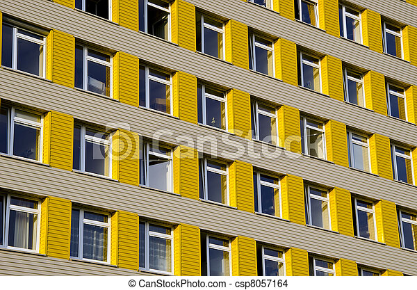 Hospital building with many windows background.