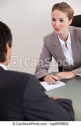 Portrait of a serious manager interviewing a male applicant - csp8058802