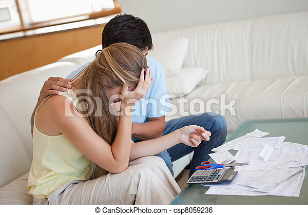 Sad couple in financial trouble - csp8059236