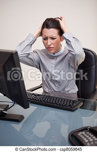Businesswoman having problems with her computer - csp8059845