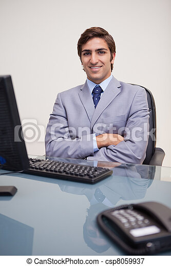 Businessman with folded arms leaning back satisfied - csp8059937