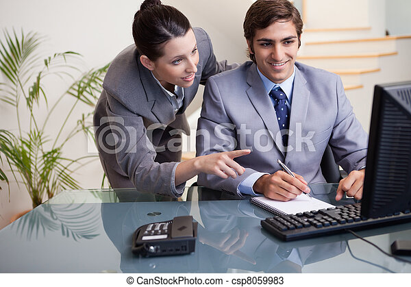 Businesswoman explaining her colleague what he has to do - csp8059983