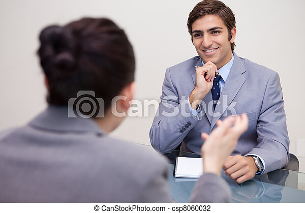 Smiling businessman in a negotiation - csp8060032