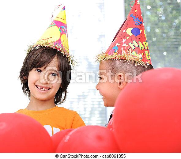 Birthday party, happy children celebrating, balloons and presents around - csp8061355