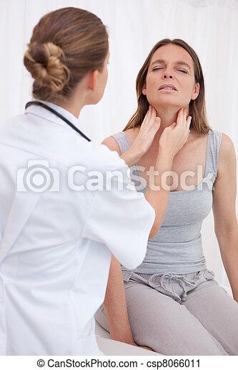 Doctor examining patients throat - csp8066011