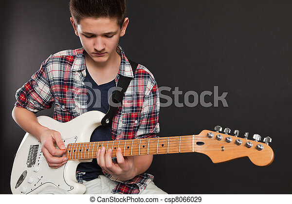 Young male playing electric guitar - csp8066029