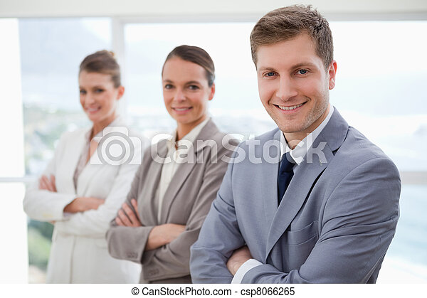 Business team standing with arms folded - csp8066265